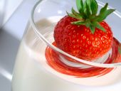 Juicy Strawberry Plunging Into Glass Of Milk With Swirl Effect