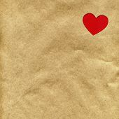 red heart on the background of kraft paper