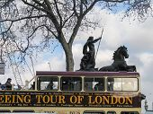 London, Uk - March 30, 2006: London Open-top Sightseeing Bus Tour Moving Near Boadicea Statue Chario