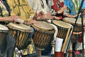 stock photo of congas  - jembe player in group wich percussion  instrument - JPG