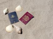 Passports On Sandy Tropical Beach With Sea Shell  And Copyspace