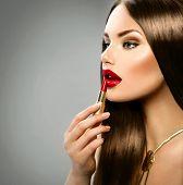 Sexy girl applying makeup. Make up. Red Lipstick. Professional Make-up. Lipgloss. Beauty Girl Applying Lip stick. Beautiful model. Glamour woman portrait