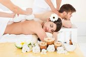 stock photo of reflexology  - Cropped image of therapist massaging woman - JPG