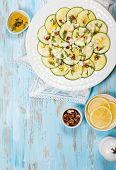 Zucchini Carpaccio with feta,walnut and dill