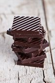chocolate sweets stack on rustic wooden background