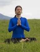 stock photo of namaste  - Man is meditating in Namaste pose outdoors - JPG