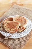 Brazilian Dessert Bolo De Rolo (swiss Roll, Roll Cake) On White Plate Sackcloth