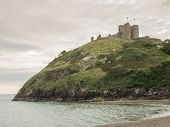 stock photo of anglesey  - Criccieth Castle in North Wales on the Anglesey peninsula dates from the 13th century - JPG
