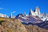 Magnificent panorama of snow-capped mountains in Patagonia. Famous rock Fitz Roy peaks in the Andes.