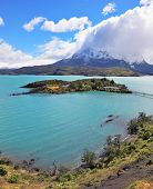 National Park Chile - Torres del Paine. Island Lake Pehoe and comfortable hotel. Easy bridge connect