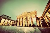 Brandenburg Gate. German Brandenburger Tor in Berlin, Germany. Illumination at night in vintage, ret