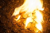 Pile of euro coins on fire