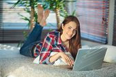 Woman Surfing The Net At Home