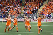 THE HAGUE, NETHERLANDS-JUNE 14,2014: Maartje Paumen (NED) runs back to cheer with her team after sco