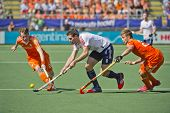 THE HAGUE, NETHERLANDS - JUNE 13: Dutch players Van Ass and De Wijn blocking England striker Simon M