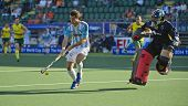 THE HAGUE, NETHERLANDS - JUNE 13: Argentinian Menini controlls the ball after a counter, ending up one on one with the Australian Goalie Carter during the Semi-Finals of the World Cup Hockey 2014