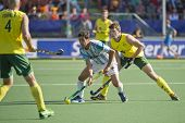 THE HAGUE, NETHERLANDS - JUNE 13: Australian Orchard challenges Argentinian Captain Rey for the ball