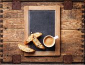 Coffee Cup And Biscotti On Vintage Slate Chalk Board