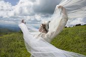 Young bride on mountain top