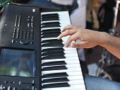 closeup shot of male hands playing the piano .Human hands playing the piano on the party