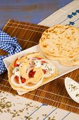 stock photo of gyro  - A portion of Gyros snack with pita bread and sauce - JPG