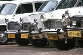 VIJAYAWADA- August 16:  Hindustan motors Ambassador cars park outside in row at taxi stand on August 16, 2008 in Vijayawada , India. Ambassador crowned world's best taxi by BBC Top Gear