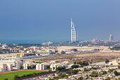 DUBAI, UAE - MARCH 30: Burj Al Arab hotel in Dubai on March 30, 2014, UAE. Burj Al Arab with 321 meters high is the most luxurious 7 star hotel and a symbol of modern Dubai.