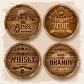 foto of keg  - Set of wooden barrels with alcohol drinks emblems - JPG