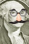 stock photo of incognito  - Novelty Glasses and Mustache on George Washington face. Close-up of one dollar bill.