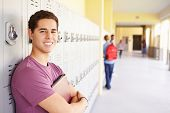 Male High School Student Standing By Lockers