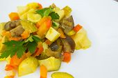 Stewed Vegetables With Curcuma On The White Plate