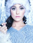 Winter face close up of young attractive woman covered with snow flakes. Christmas concept.