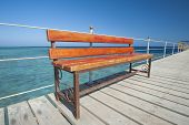 Wooden Bench On Tropical Jetty