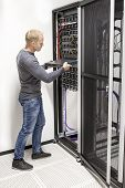 IT consultant build network rack in datacenter