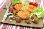 Salmon Medallion, Stuffed Snails And Mushrooms On A Plate