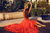 Fashion Photo Of Brunette Woman In Luxurious Red Dress