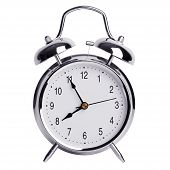 Five Minutes To Eight On A Round Alarm Clock
