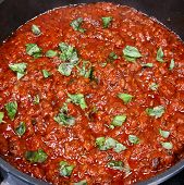 Bolognese sauce with basil