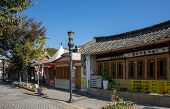 JEONJU, SOUTH KOREA - 03 NOVEMBER 2014: Traditional Korean Hanok village houses convert to modern restaurant and shops to serve visiting tourists in a booming tourism industry in South Korea.