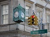 stock photo of broadway  - Broadway clock and red sign on the traffic light - JPG