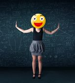 Funny businesswoman wears yellow smiley face