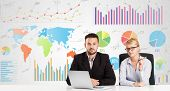Business man and woman with colorful charts graphs