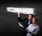 Young couple touching web browser address bar with www sign