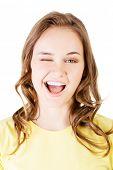 Portrait of happy woman blinks her eye.