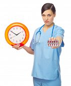 Young doctor with pills and clock isolated