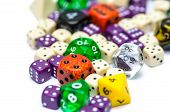 pic of dice  - multiple colorful role playing dices lying on isolated background  - JPG