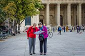 Two senior women check their map at Place St. Sulpice
