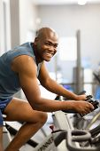 healthy african american man exercising in gym
