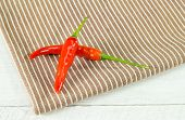 Two Chili Peppers On A Napkin
