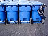 Blue Wheeled Trash Cans And Plastic Garbage Bag